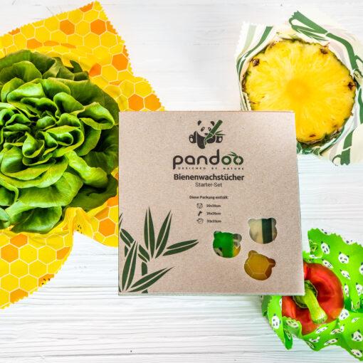 Förpackningen med tre bivaxdukar och exempel på hur de kan avändas till sallad, ananas och paprika.
