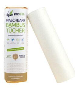 Rulle med vita tvättbara dukar av bambu brevid rulle inslagen i brunt papper.